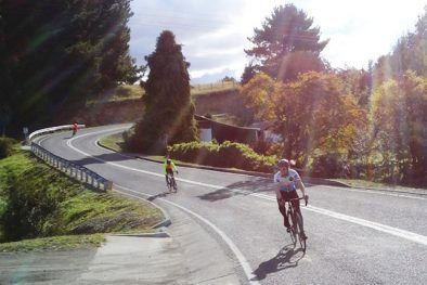 Three Cyclists during Road Cycling Tour in Chile´s Lake District