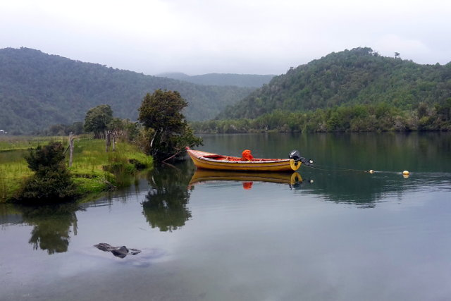 River and Fisher Boat in Mapu Lahual in Chile